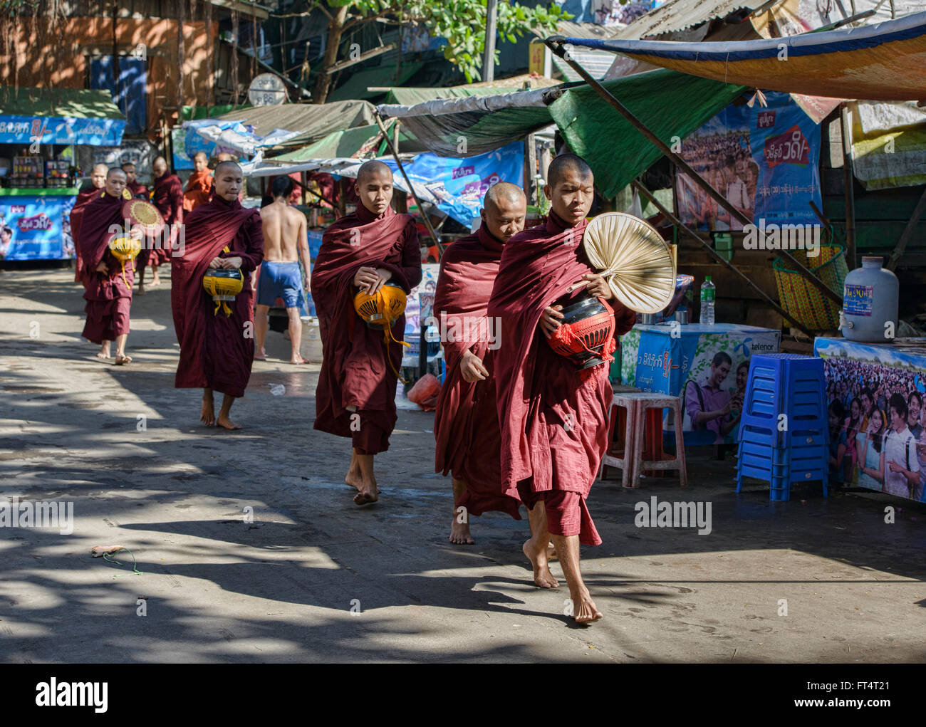 Monks on their morning alms rounds, Yangon, Myanmar - Stock Image