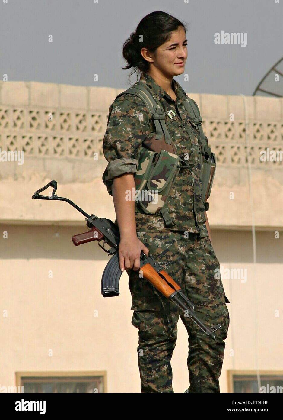 A Female Soldier With The Kurdish Ypg During Operations