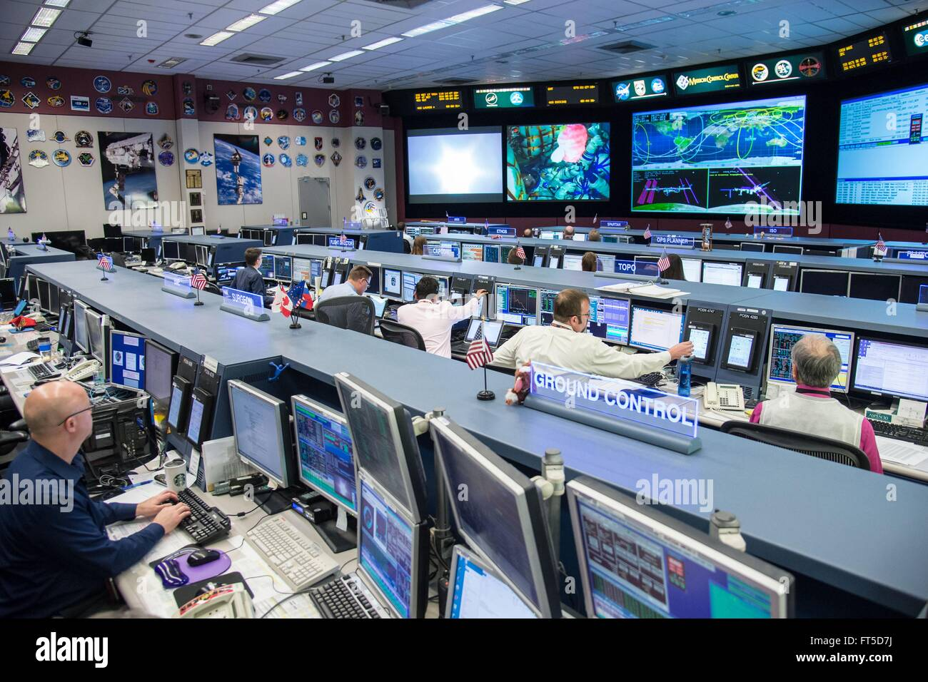 NASA Expedition 47/48 flight control team monitor the launch of the Soyuz TMA-20M spacecraft at mission control - Stock Image