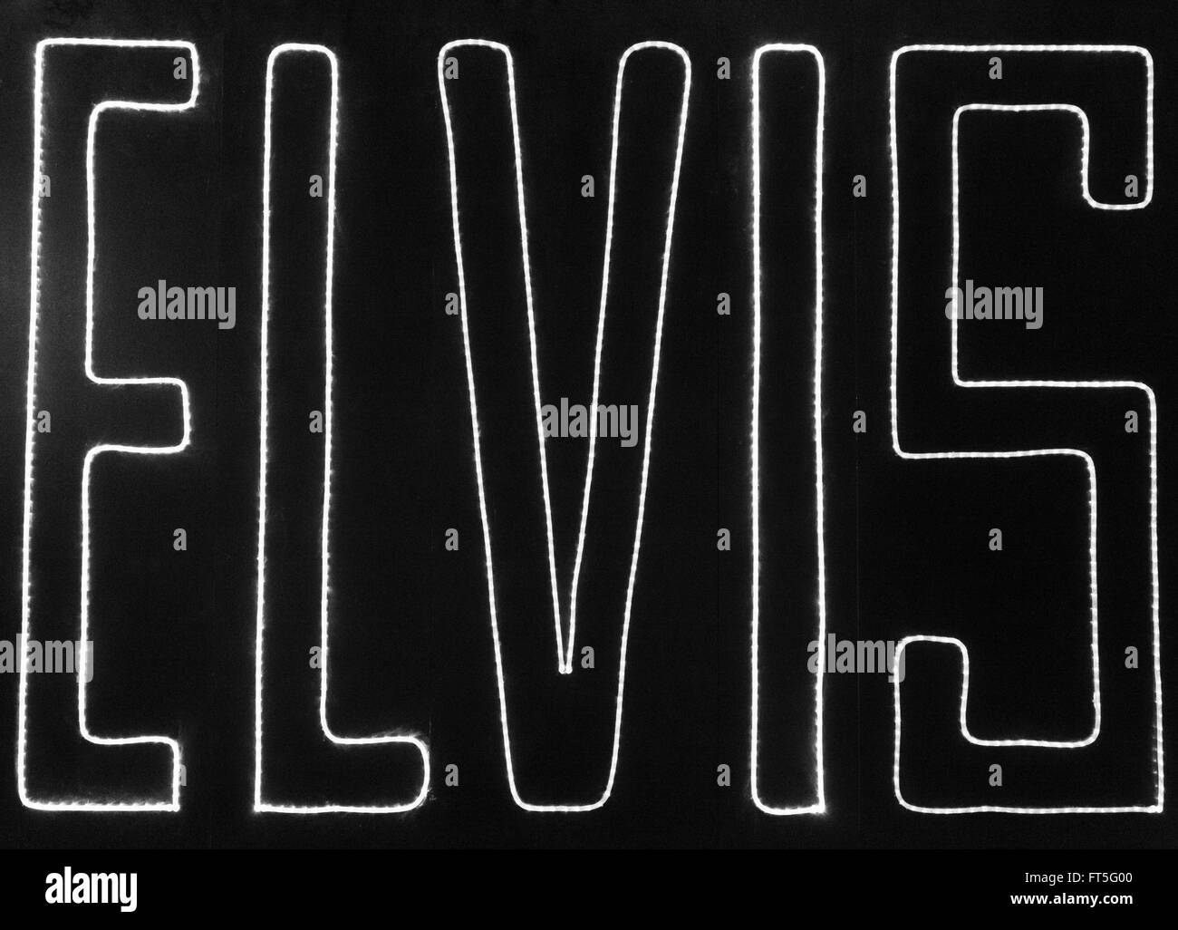 A photograph of a neon signing saying 'ELVIS'. The photograph was taken in Memphis, Tennessee. - Stock Image
