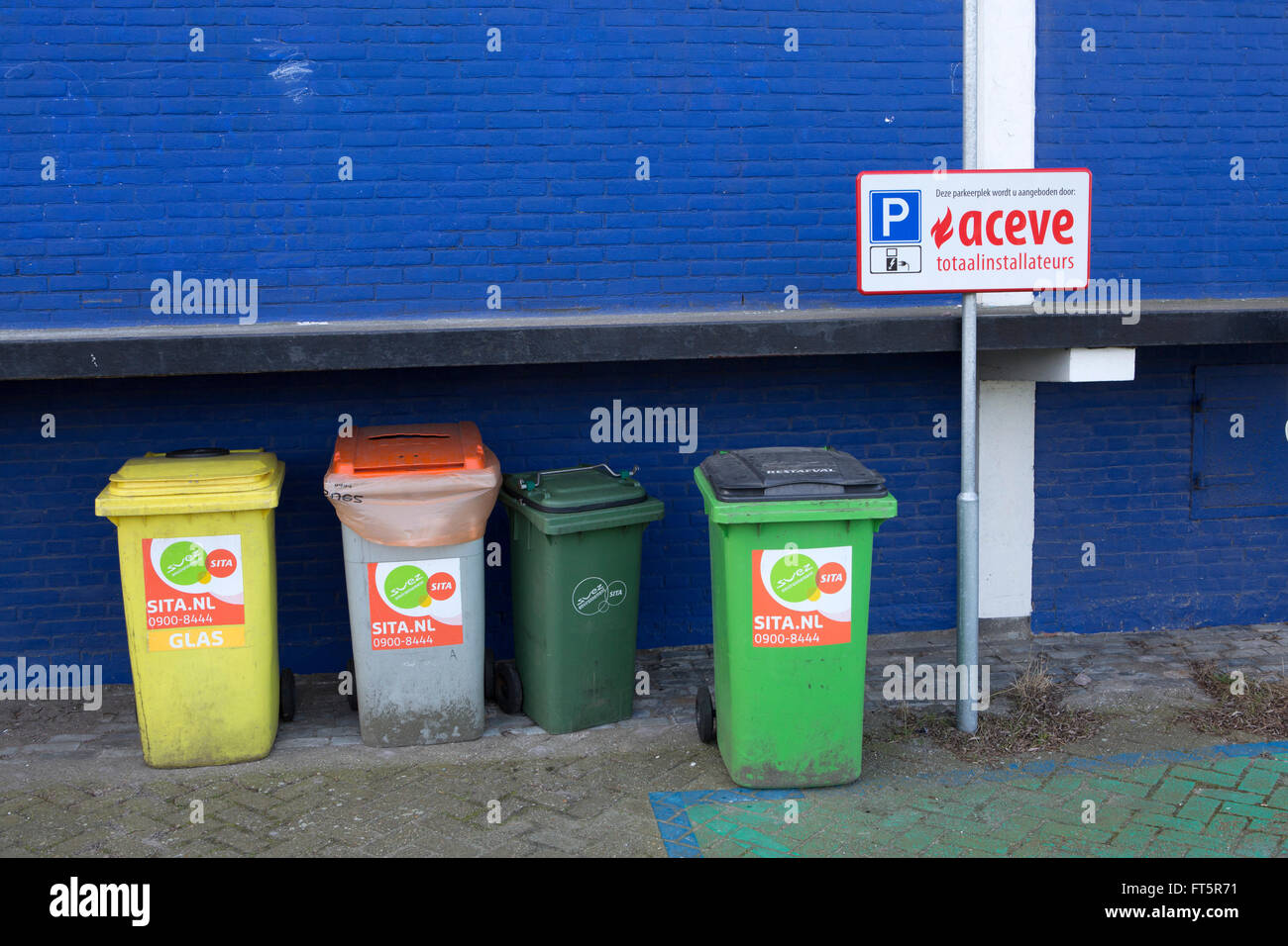 Trash cans at Uit Je Eigen Stad in Rotterdam, the Netherlands. The bis are used for recycling and disposing of general - Stock Image