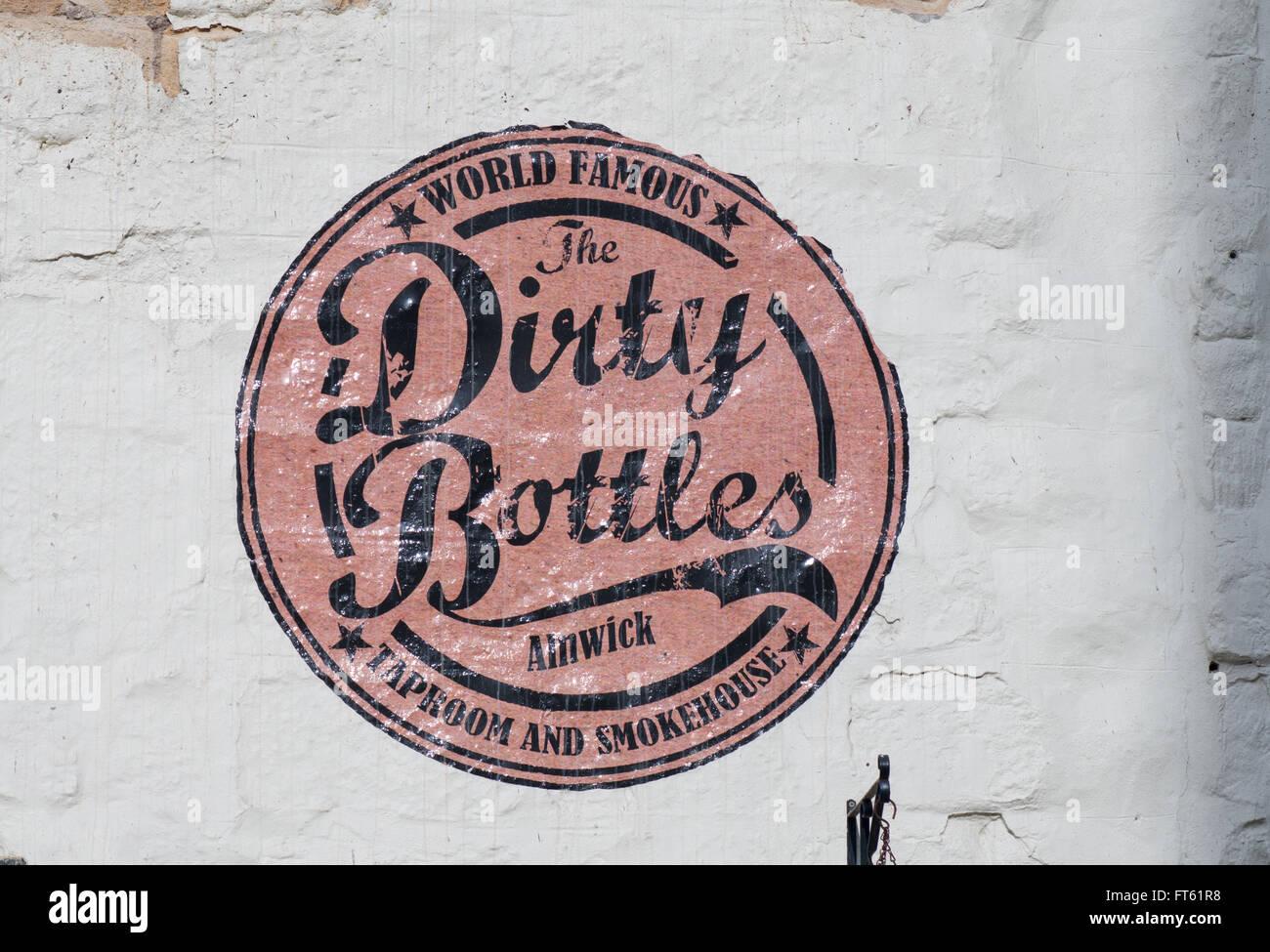 Sign on Ye Old Cross pub or Dirty Bottles Alnwick , Northumberland , England, UK - Stock Image