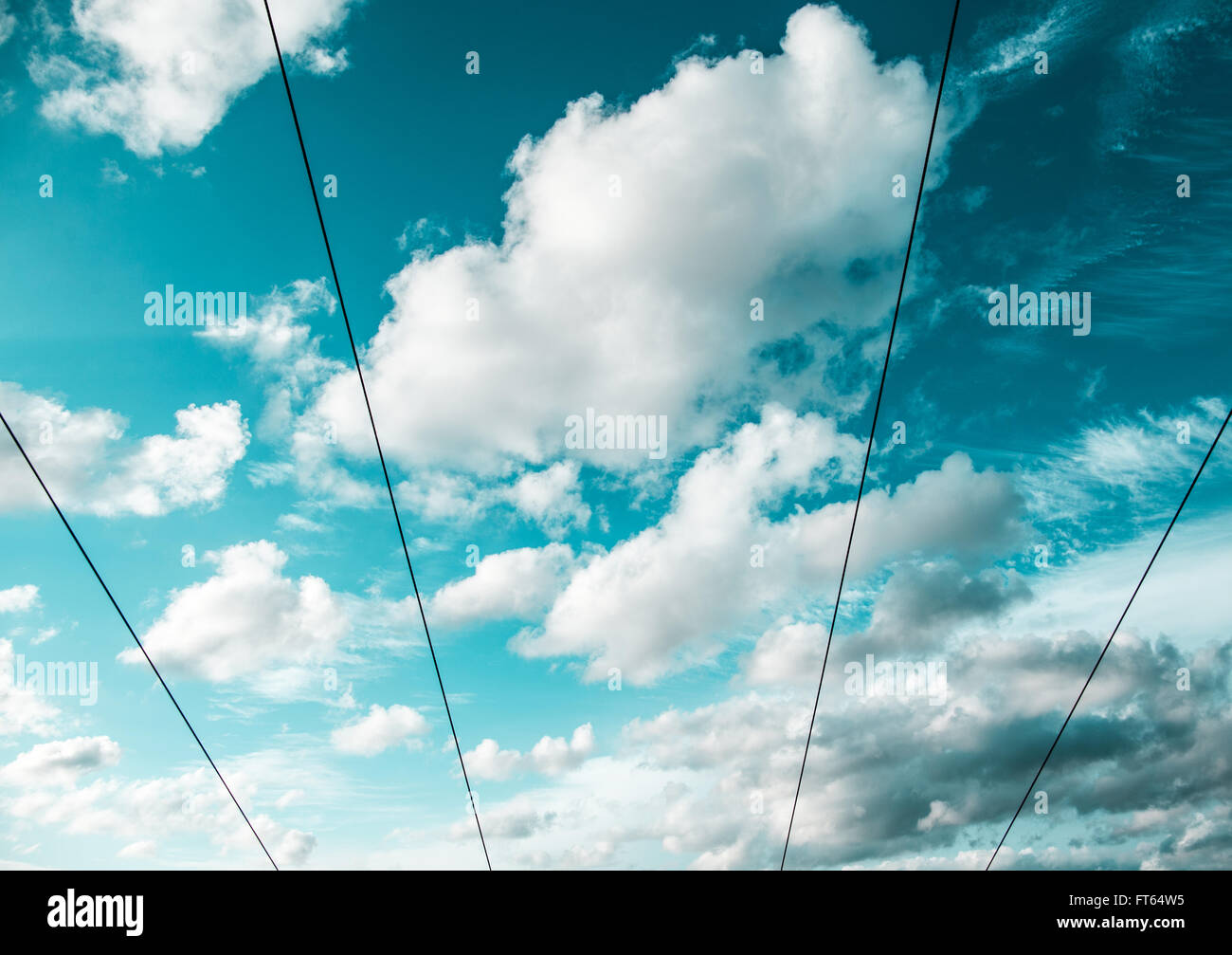 Low angle view of ski-lift cables against cloudy sky - Stock Image
