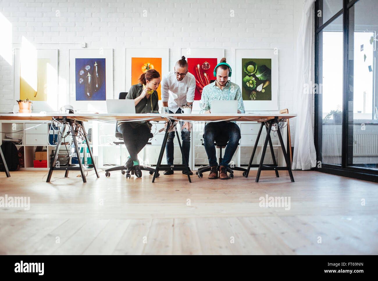 Creative business people working together in office - Stock Image
