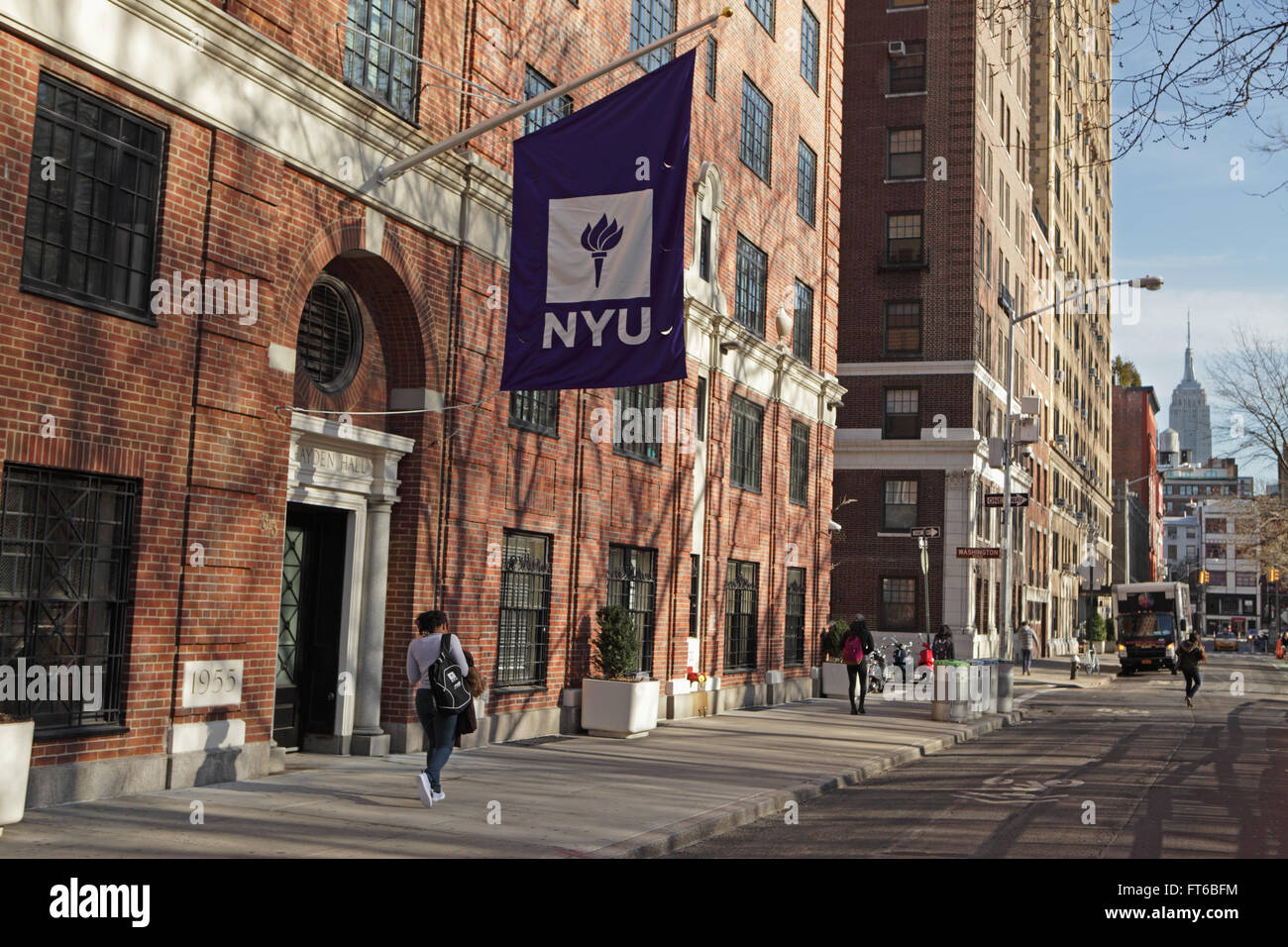 New York University Buildings With The Purple NYU Logo Flag Hanging Outside  The Entrance