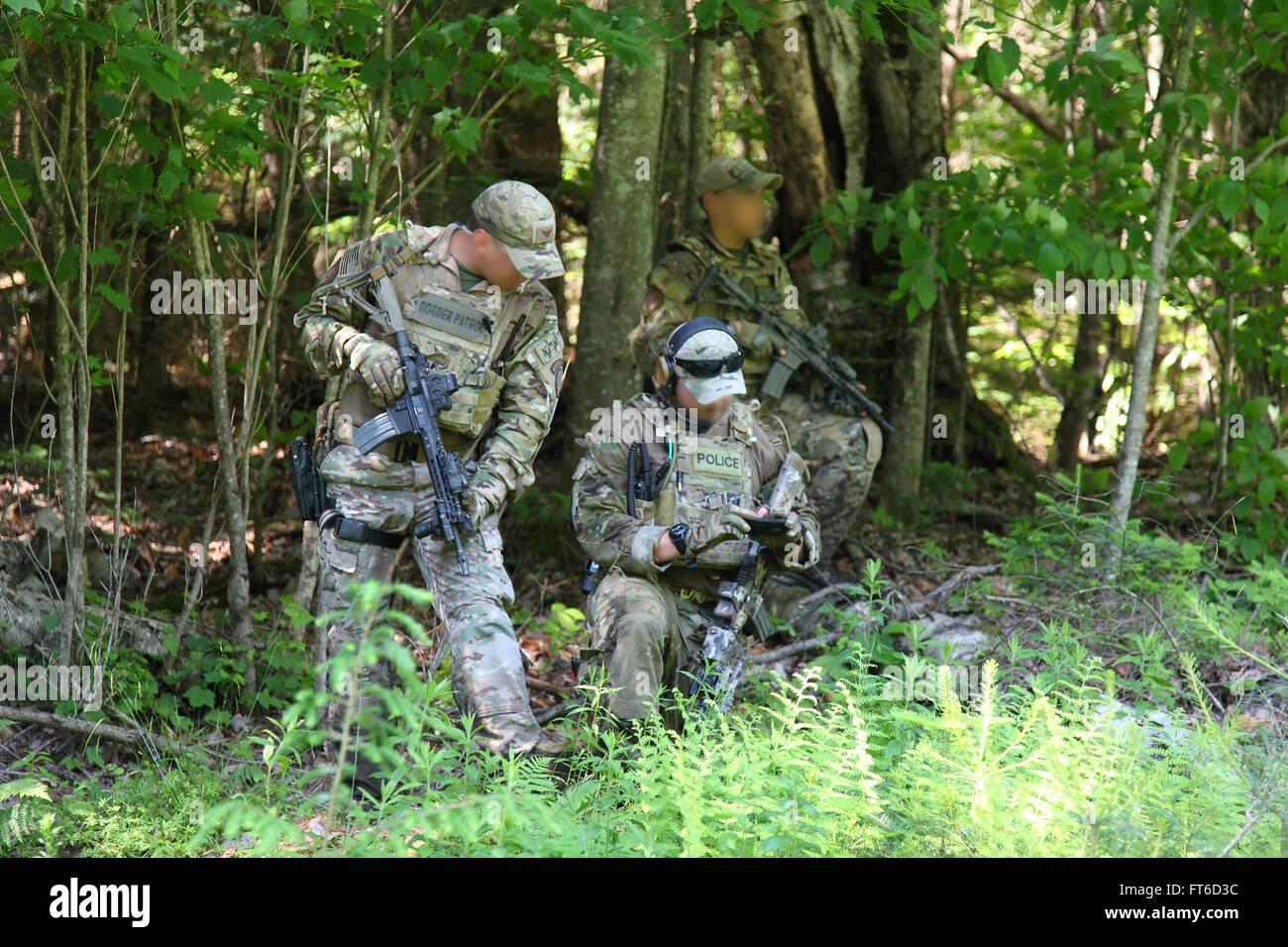 BORTAC team members search for clues in the Richard Matt and David Sweat manhunt on June 14. Photographer: Kristoffer - Stock Image