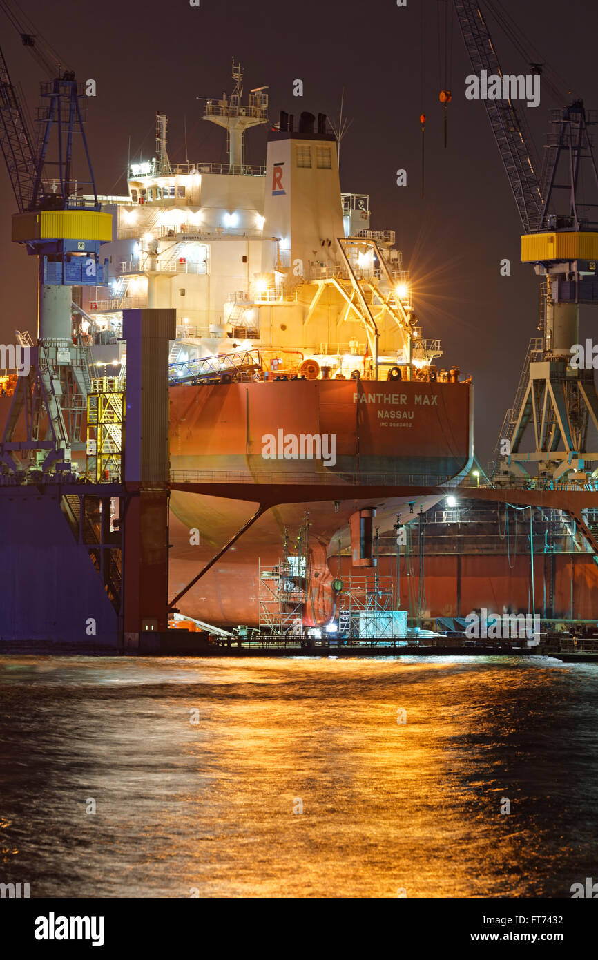 Cargo ship in the dry dock of Blohm und Voss, Hamburg, Germany, Europe - Stock Image