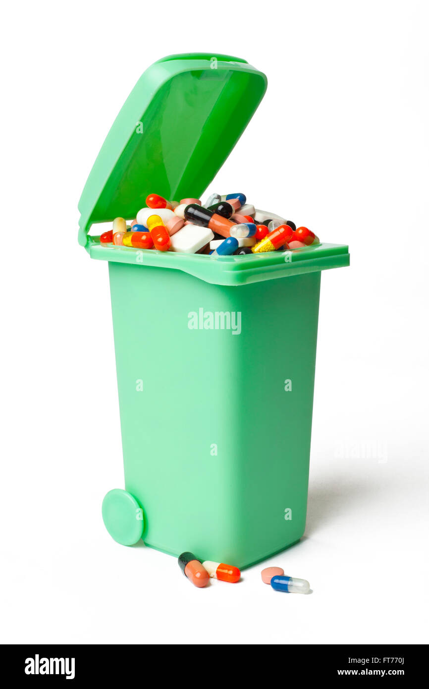 Garbage Can Full of Pills - Stock Image