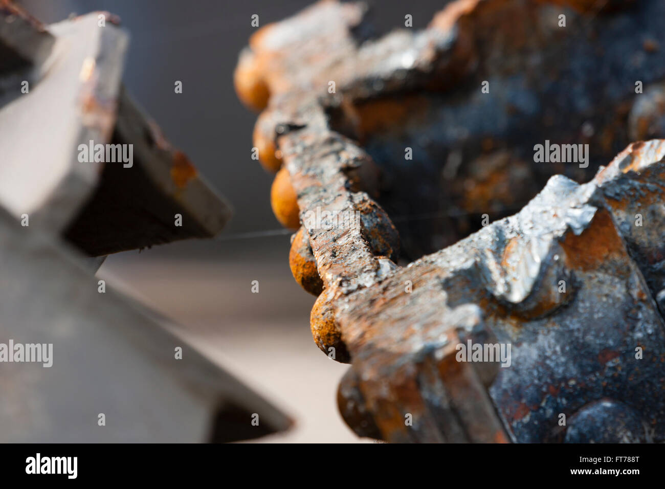 Detail shot of cut rusty steel beams from an old bridge. - Stock Image