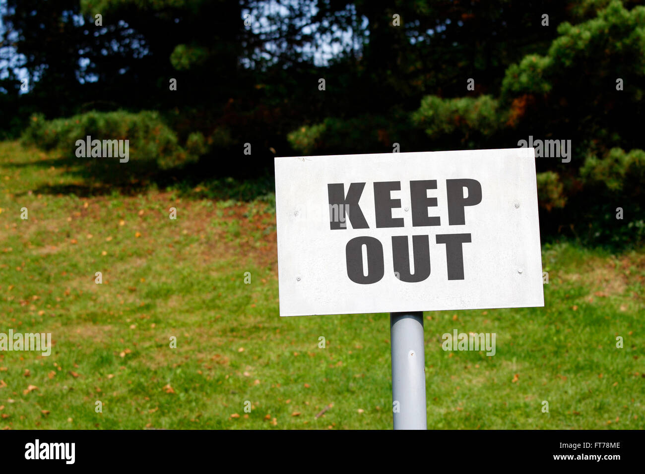 Keep out sign in a rural field - Stock Image