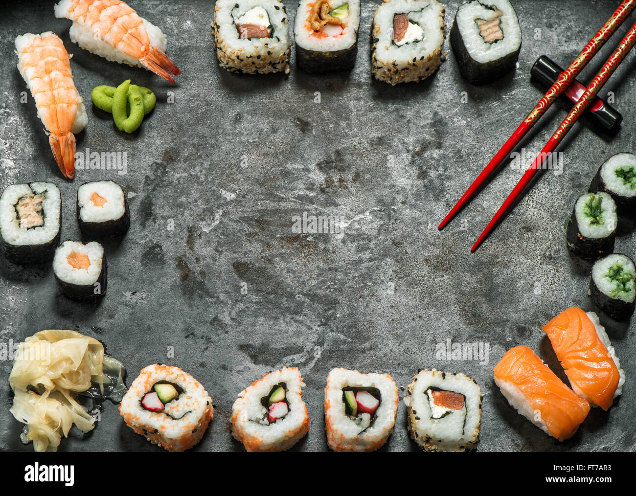 Traditional japanese food. Sushi rolls, nigiri, salmon, wasabi, shrimp, tuna, ginger, tofu, rice, avocado, pickled - Stock Image