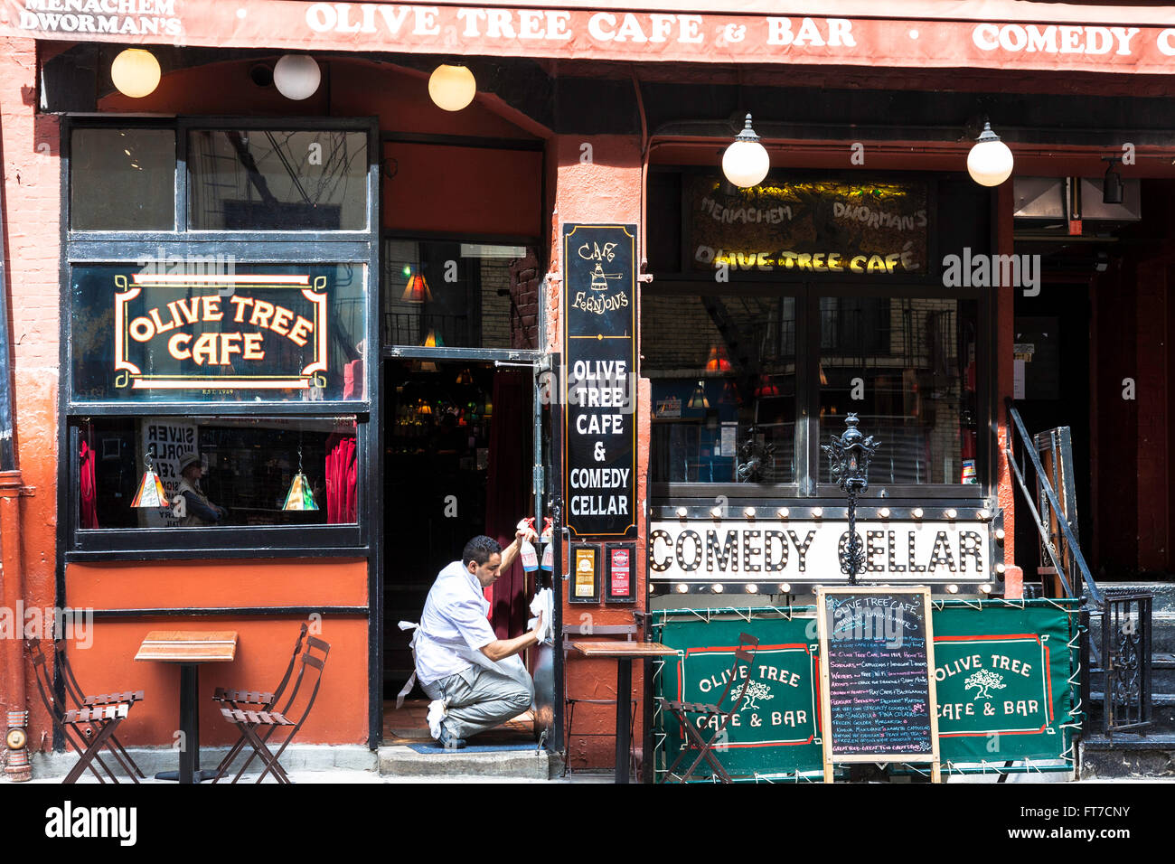 Cafe Employee Readying Place for Opening, Greenwich Village, NYC Stock Photo