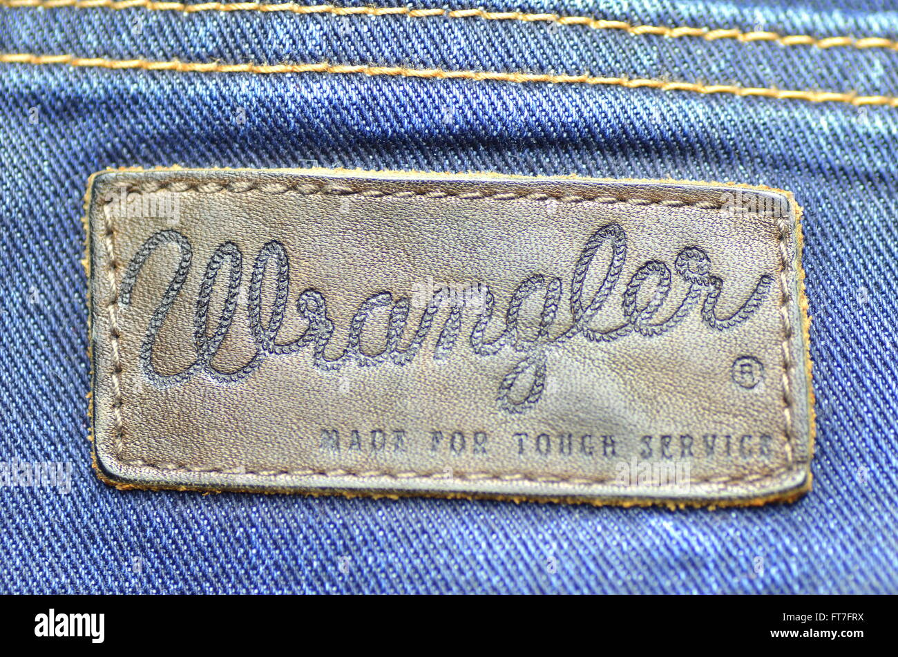1544cc27 Closeup of Wrangler label on blue jeans Stock Photo: 100969678 - Alamy
