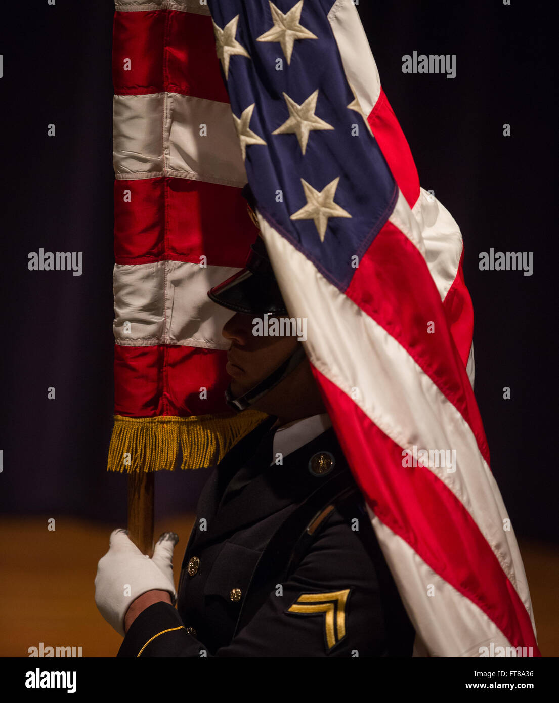 A U.S. Army Honor Guard member carries the Flag at the opening of the 2015 National Native American Heritage Month - Stock Image