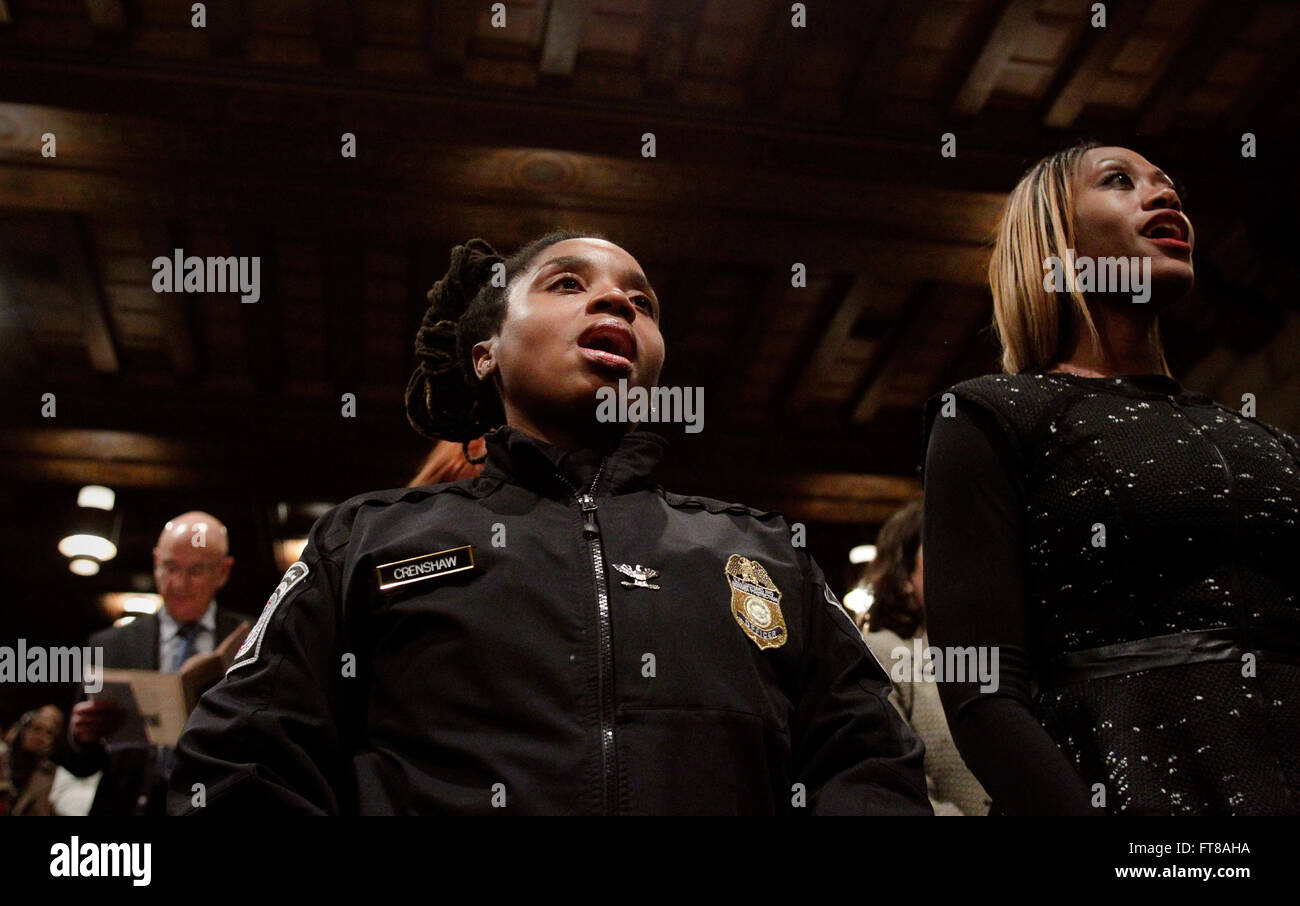 U.S. Customs and Border Protection Officer Samara Crenshaw sings the Negro National Anthem with the audience at - Stock Image