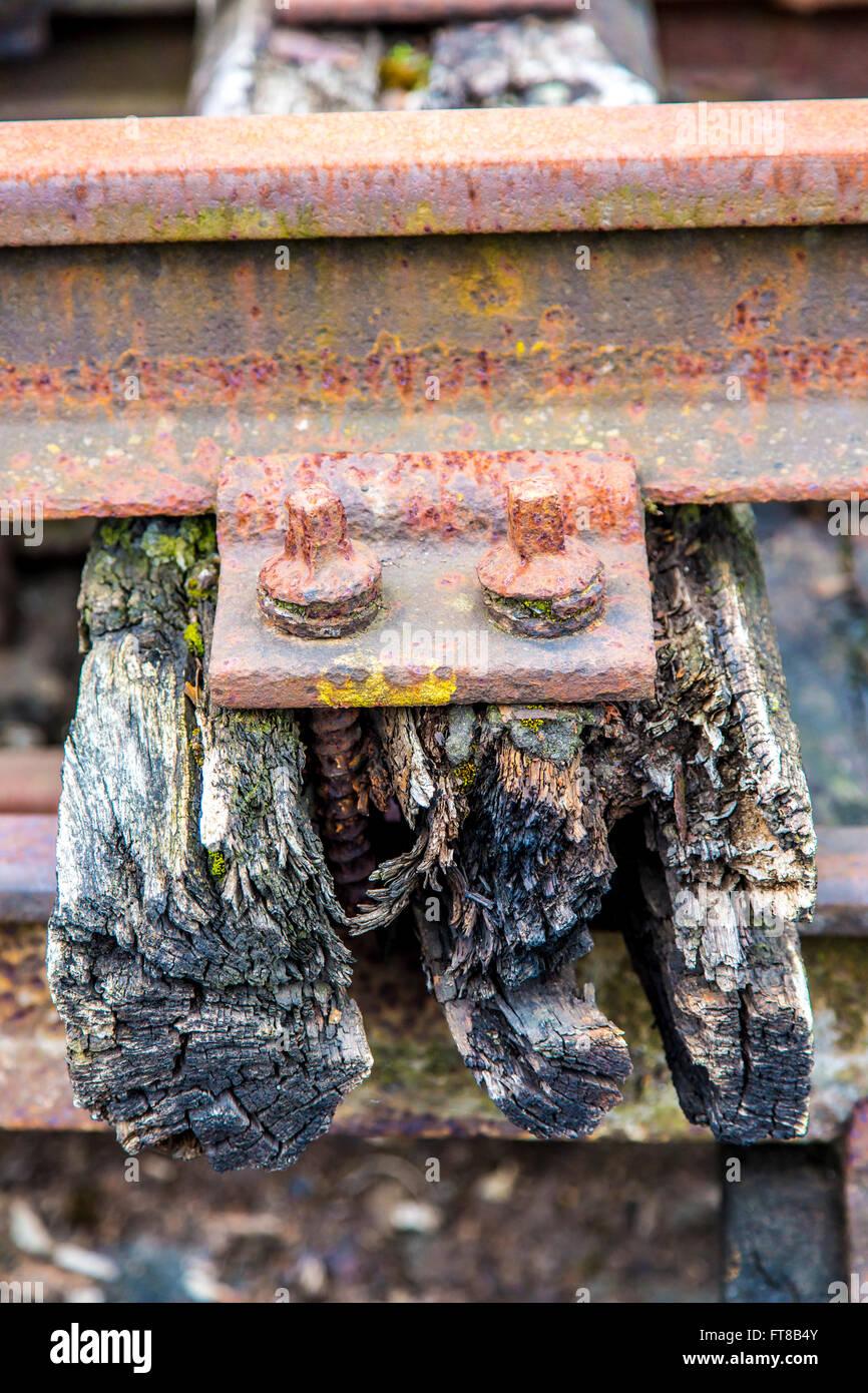 Old railway track, on a wooden crosstie, railway sleeper, decayed, - Stock Image