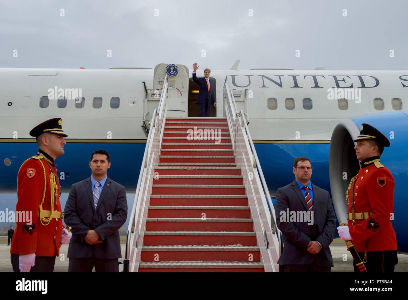 U.S. Secretary of State John Kerry waves goodbye on February 14, 2016, as he prepares to depart from Tirana International - Stock Image