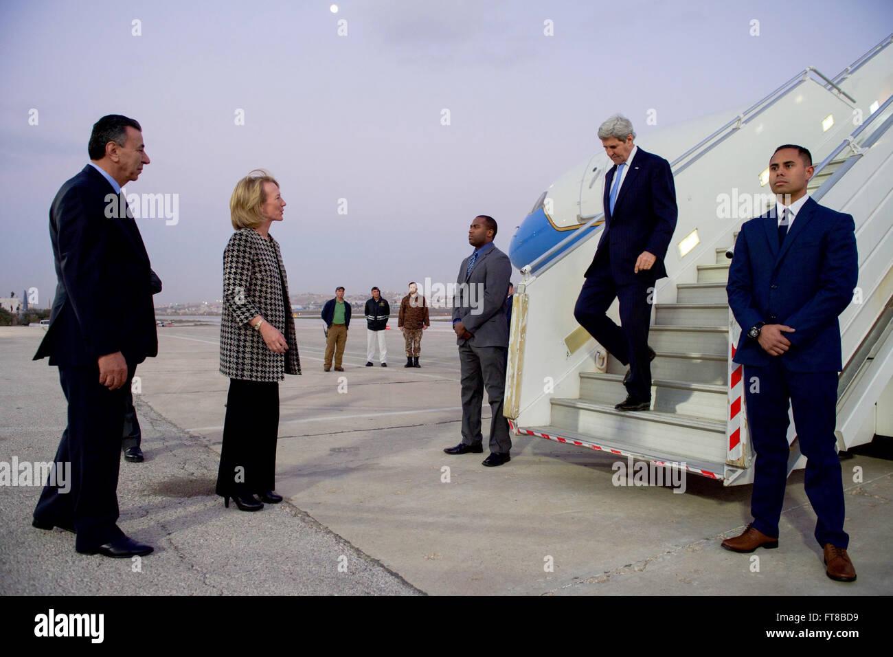 U.S. Ambassador to Jordan Alice Wells stands under a near-full moon as she awaits U.S. Secretary of State John Kerry - Stock Image