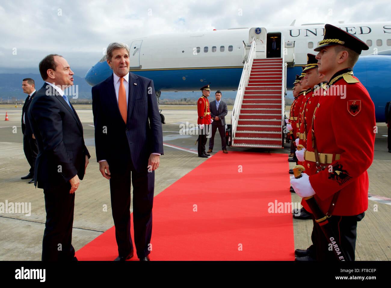 U.S. Secretary of State John Kerry chats with Albanian President Bujar Nishani after arriving at Tirana International - Stock Image