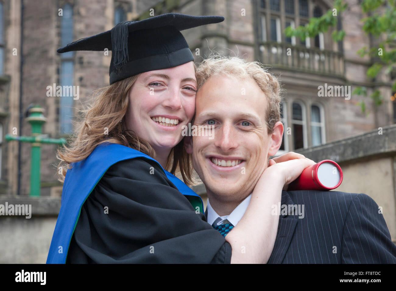 Edinburgh, City of Edinburgh, Scotland. Young couple celebrating graduation from the University of Edinburgh. - Stock Image