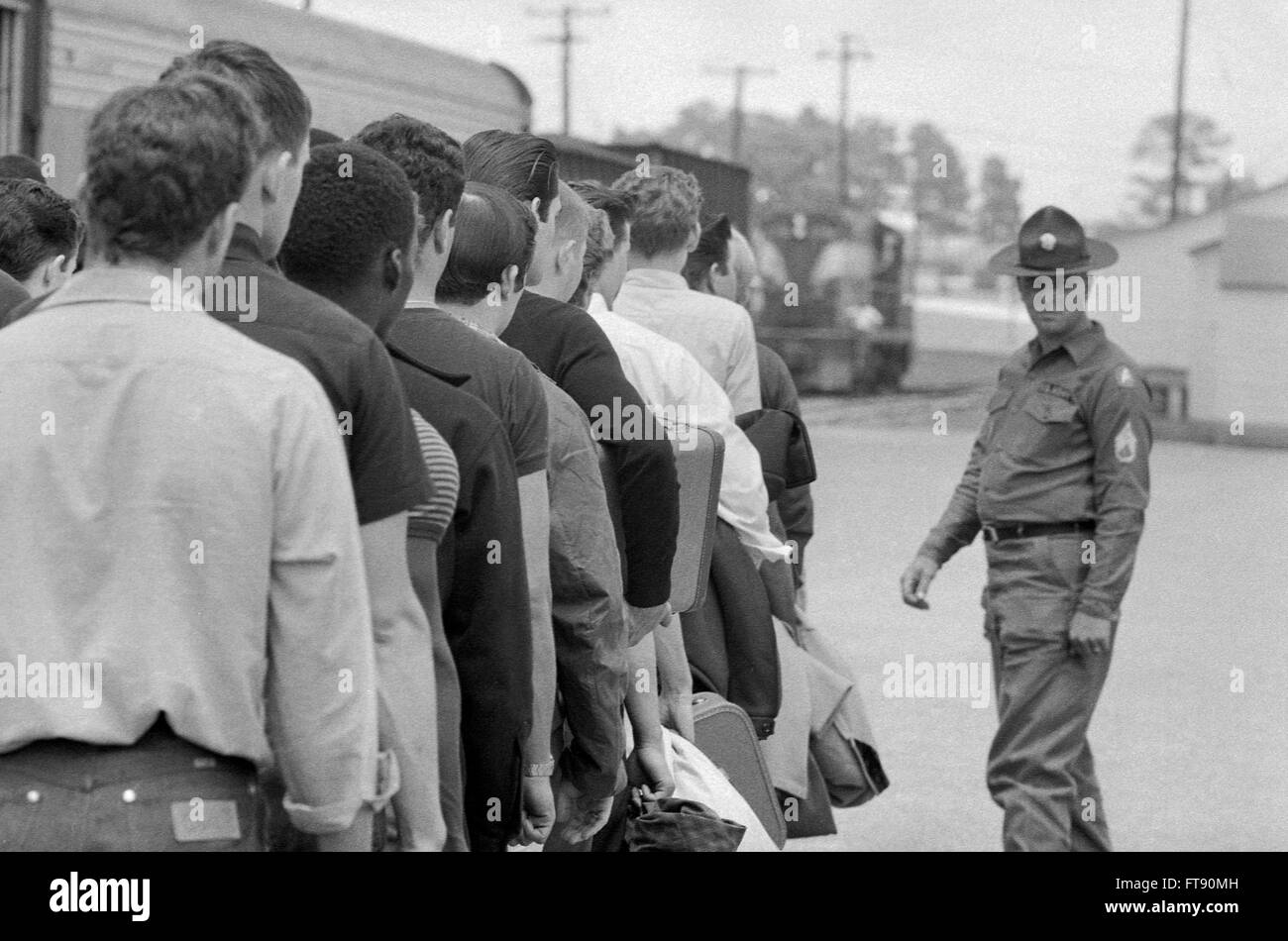 Vietnam Draft. Young men who have been drafted wait in line to be processed into the U.S. Army at Fort Jackson, - Stock Image