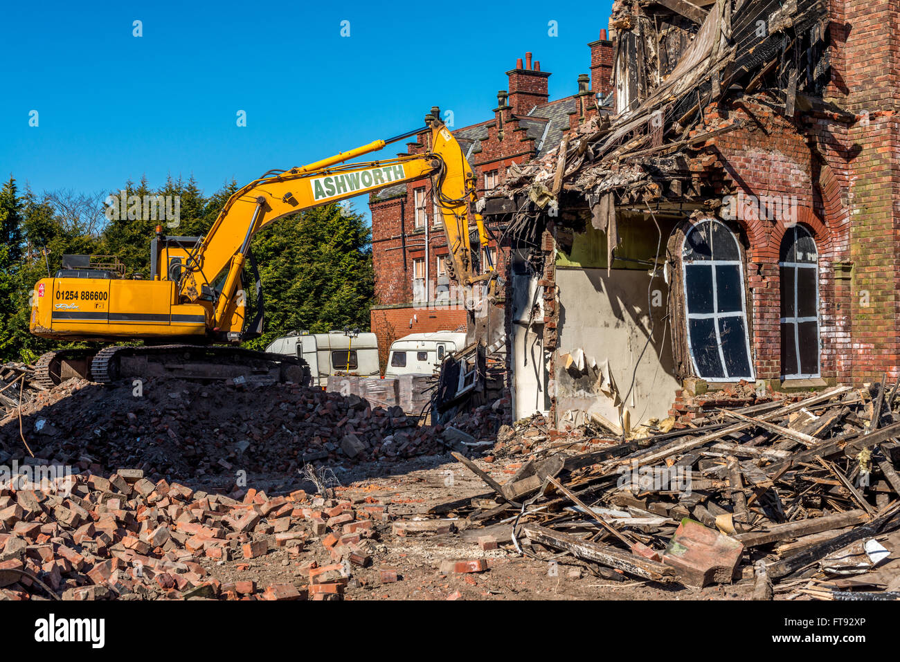 An old building being demolished following fire damage. Stock Photo