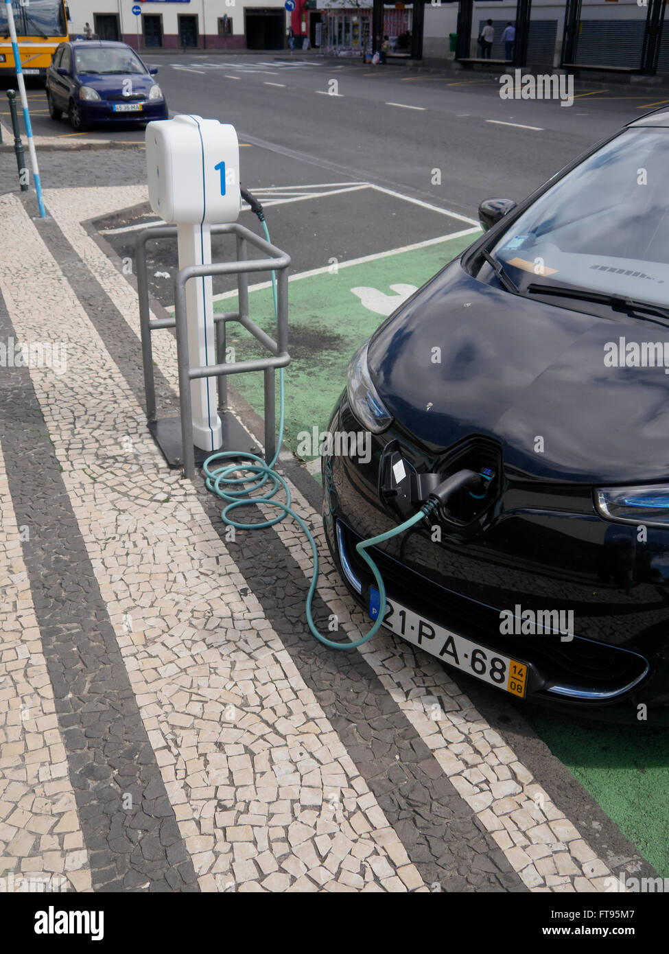 Electric car being charged at public charging point, Madeira, Portugal, March 2016 - Stock Image