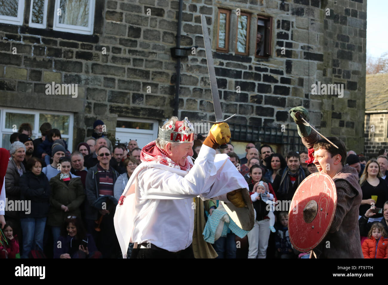 Heptonstall, UK, 25th March 2016. St george with his sword in action during a pace egg play in Heptonstall, UK, Stock Photo