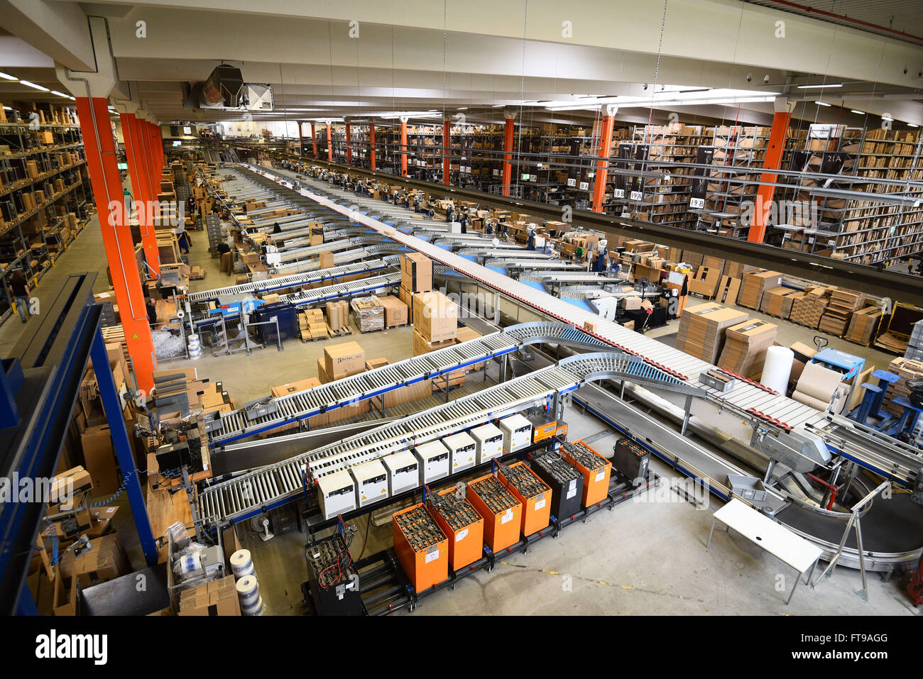 Treppendorf, Germany. 24th Mar, 2016. Numerous boxes can be seen in a warehouse at the Musikhaus Thomann in Treppendorf, - Stock Image
