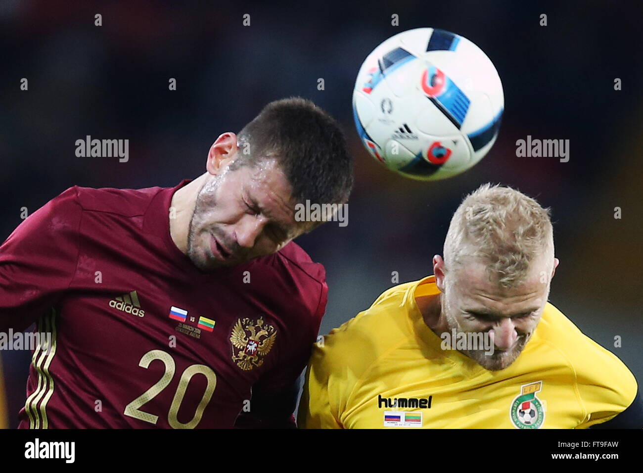 Moscow, Russia. 26th Mar, 2016. Russia's Fyodor Smolov (L) and Lithuania's Vytautas Andriuskevicius fight - Stock Image