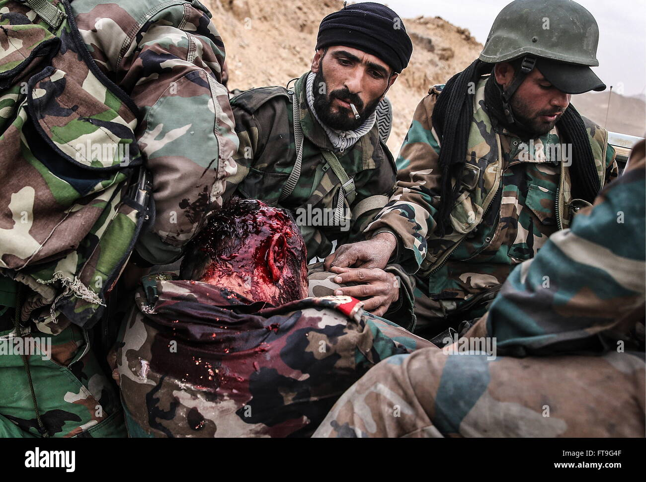 Palmyra, Syria. 26th Mar, 2016. An injured soldier of the Syrian government army at the Fahkr ad-Din al-Maani castle - Stock Image