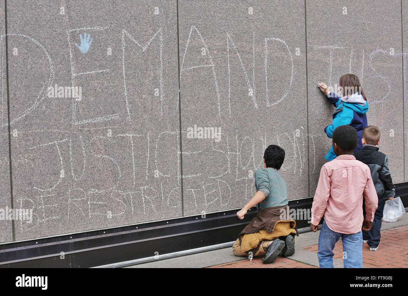 Minneapolis, Minnesota, USA. 26th March, 2016. Children write with chalk on the building, as Black Lives Matter - Stock Image