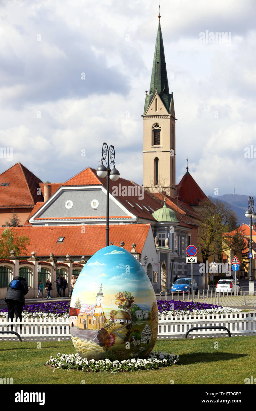 ZAGREB, CROATIA - MARCH 26, 2016 : Three easter eggs painted with technique naive by hand are placed on the Kaptol Stock Photo