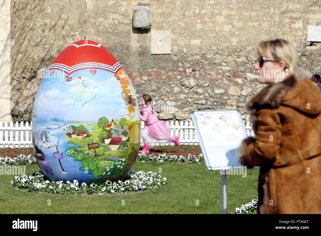 ZAGREB, CROATIA - MARCH 26, 2016 : Three easter eggs painted with technique naive by hand are placed on the Kaptol - Stock Image