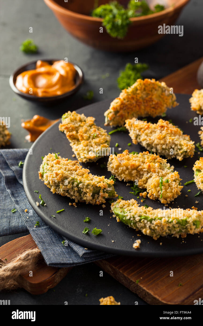 Homemade Breaded Fried Avocado Fries with Chipotle Sauce - Stock Image
