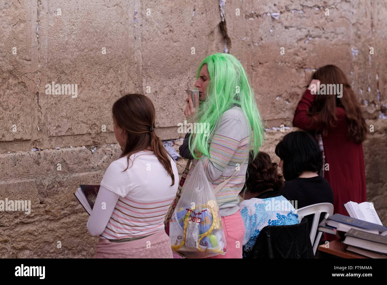A Jewish Woman Wearing A Green Color Costume Wig Praying During The