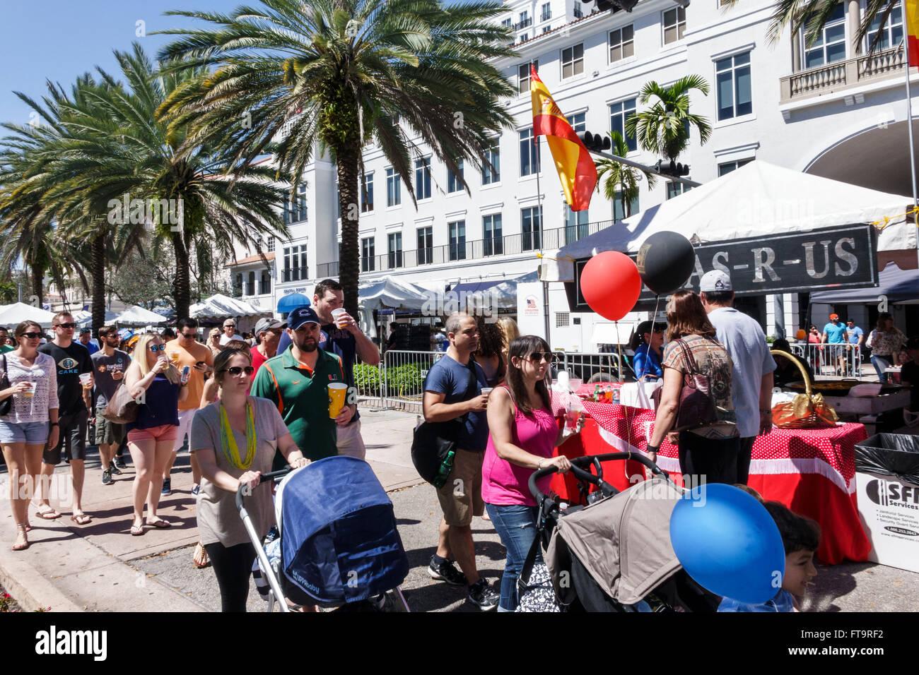 Florida FL Miami Coral Gables Carnaval Carnival Miracle Mile street festival annual celebration Hispanic man woman - Stock Image