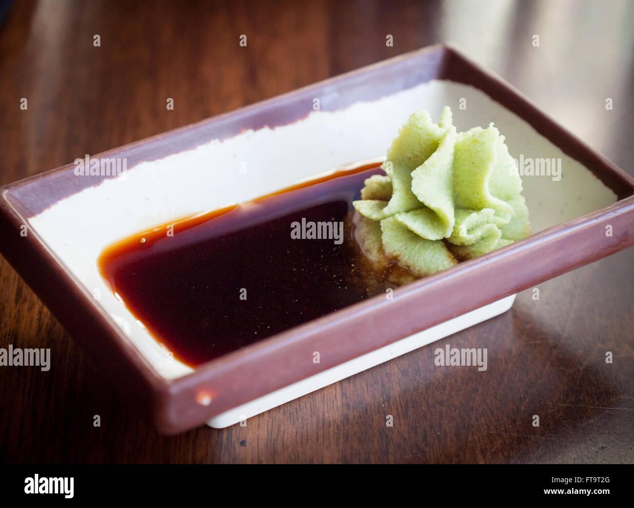 Imitation wasabi (seiyo-wasabi) paste and soy sauce. - Stock Image