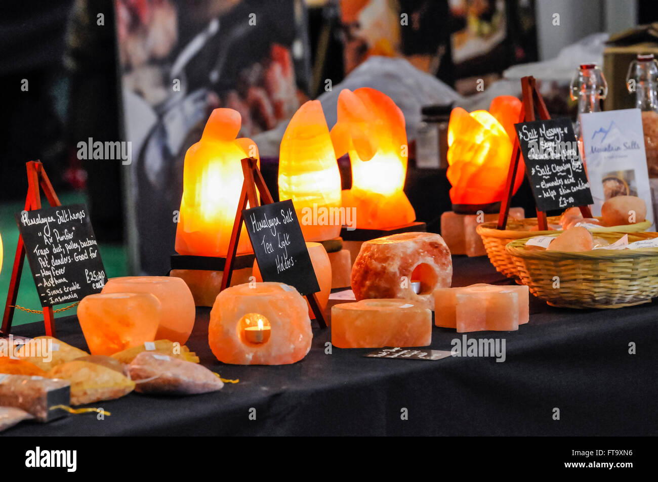 Lisburn, Northern Ireland. 25 Mar 2016 - Himalayan salt lamps on sale at a holistic and spiritual fair.  They are - Stock Image