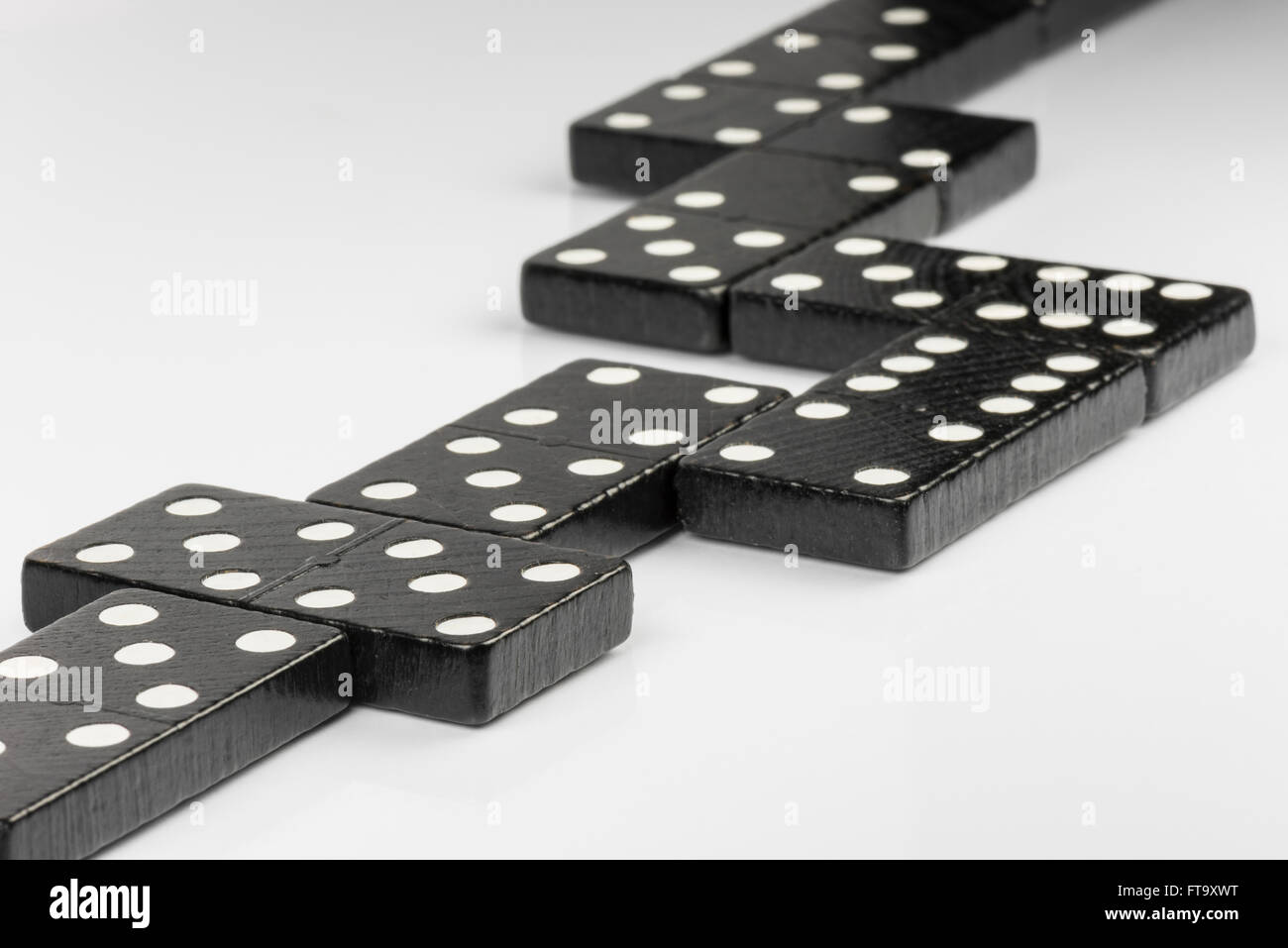 Composition of lying black domino bricks with white dots - Stock Image
