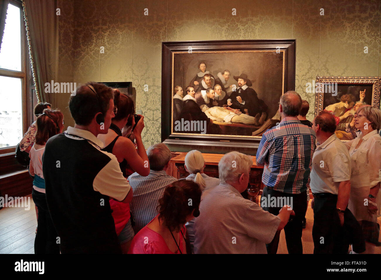 Visitors Admire The Anatomy Lesson Of Dr Nicolaes Tulp By