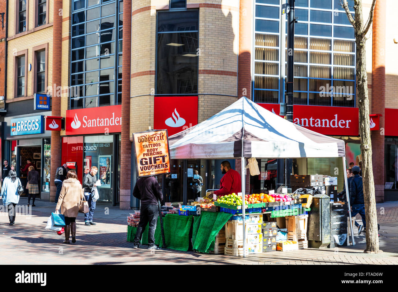 Man with placard advertising board advert for tattoos Nottingham City UK England GB Nottinhamshire - Stock Image