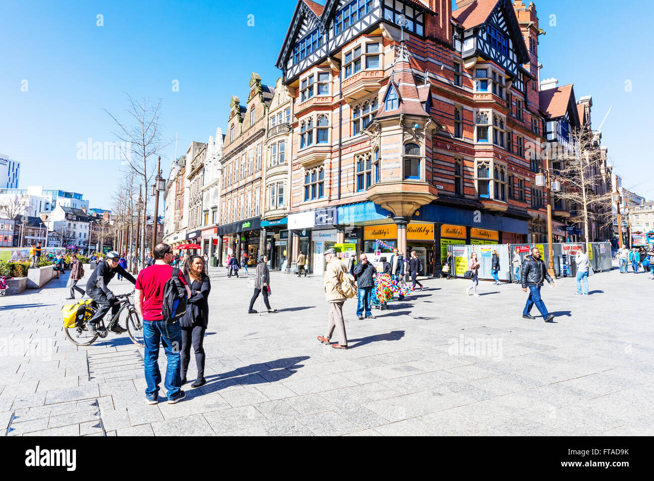 Nottingham City centre center UK busy streets street shops shoppers shopping stores shop store people England GB - Stock Image