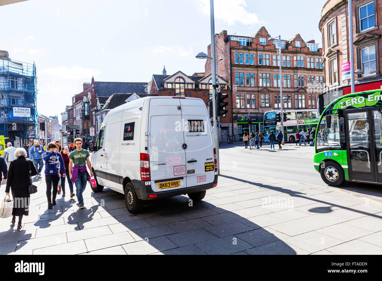 88d04bb1a86ced Loomis security van parked on path collecting money secure safe Nottingham  City UK England GB Nottinhamshire