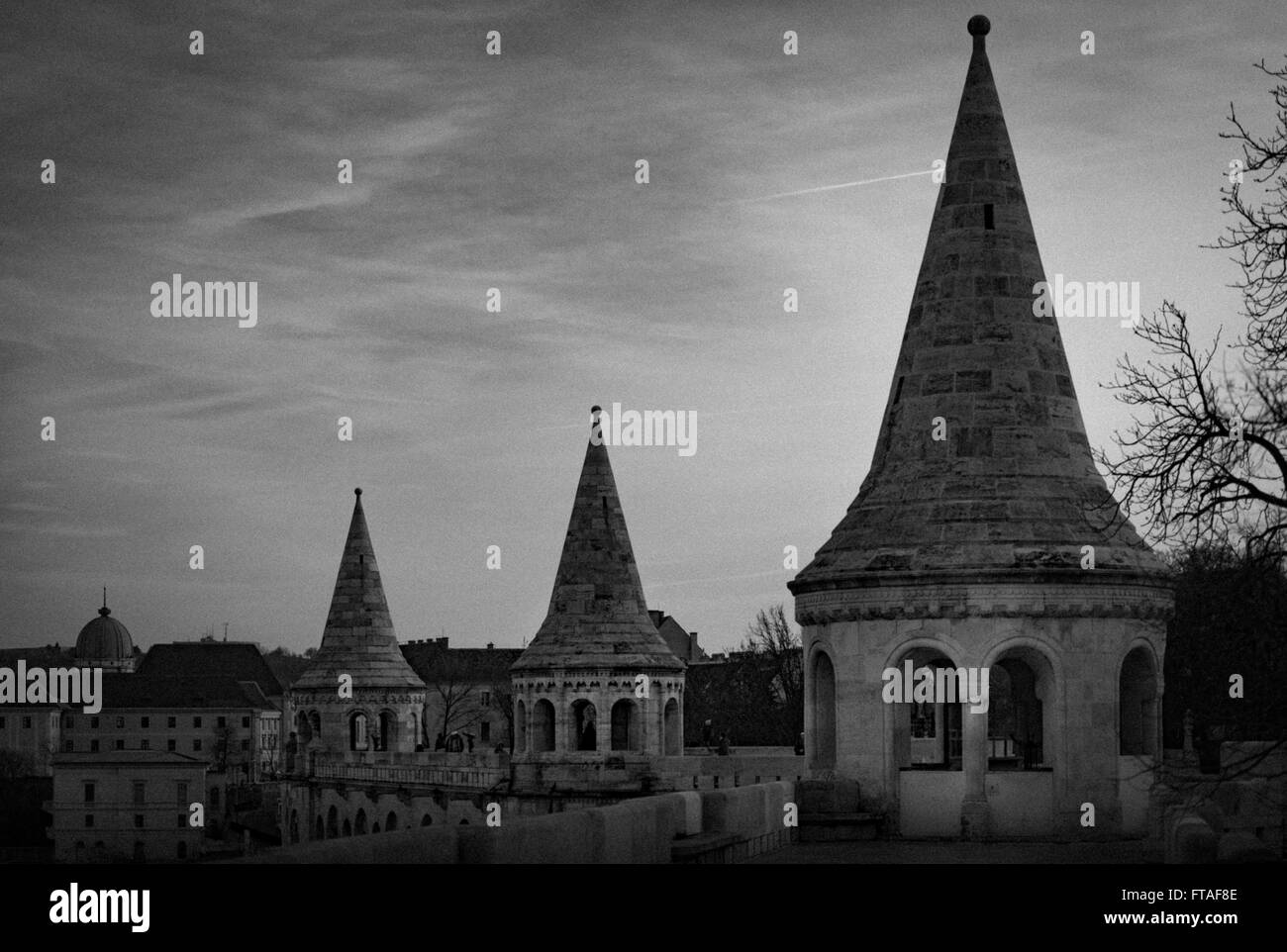 Black and white view on towers of fisherman bastion. Buda hill, Budapest, Hungary, Europe travel. Some grain added. - Stock Image