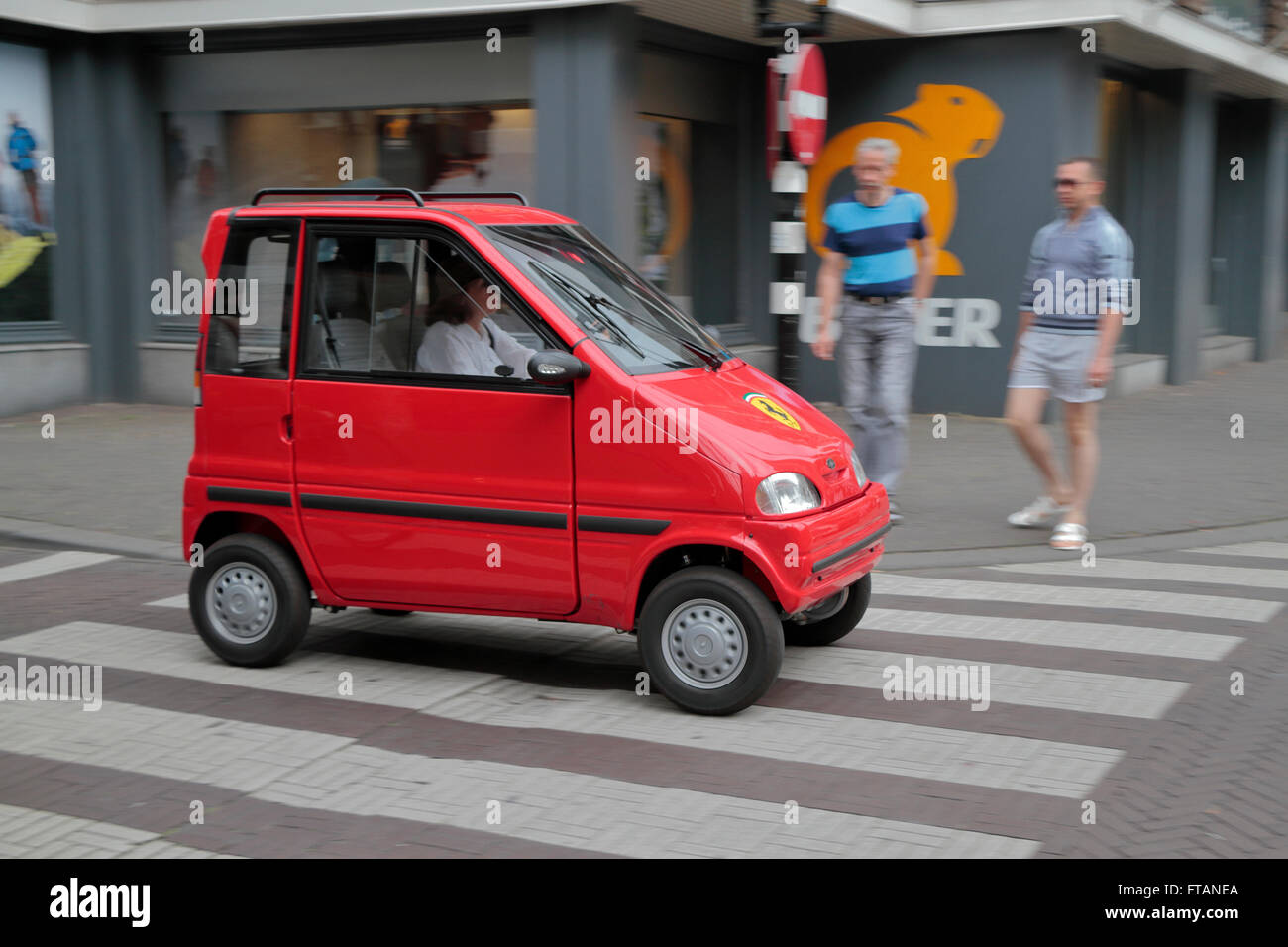 A Canta two-seat microcar specifically created for disabled drivers in the Netherlands, The Hague, Netherlands. - Stock Image