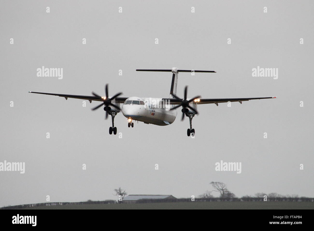 G-FLBB, a de Havilland DHC-8-400 (or Bombardier Q400) operated by the airline Flybe, during training at Prestwick - Stock Image