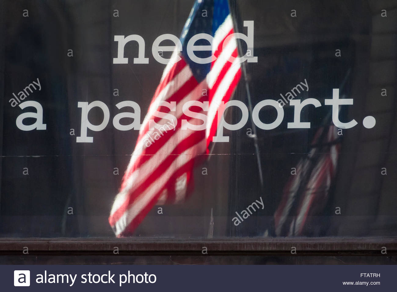 USA immigration issues: Need a passport sign with United States flag reflected on a glass window. - Stock Image