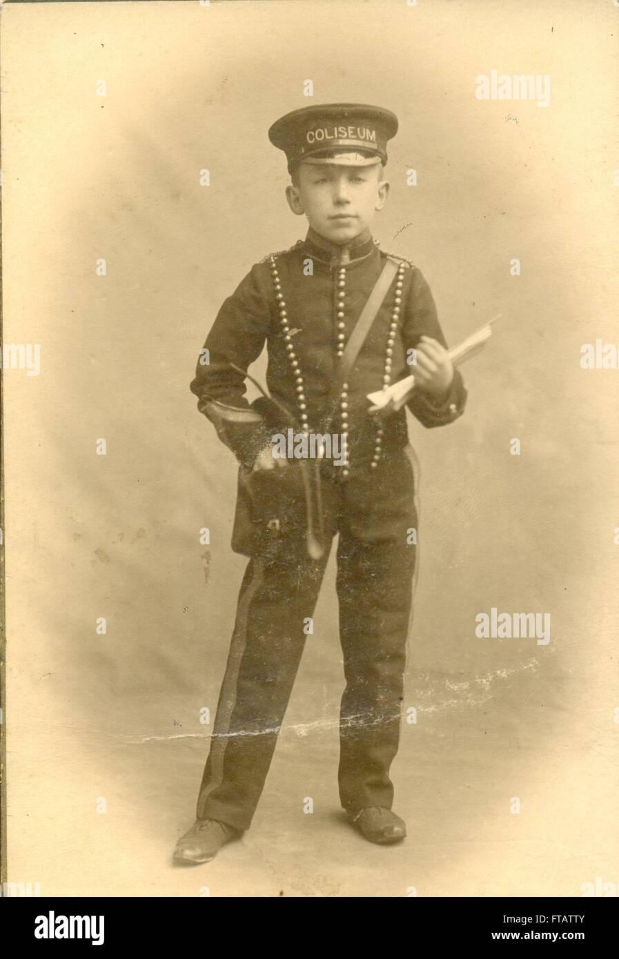 Portrait photograph of pageboy program seller.    London Coliseum designed by Frank Matcham - Stock Image