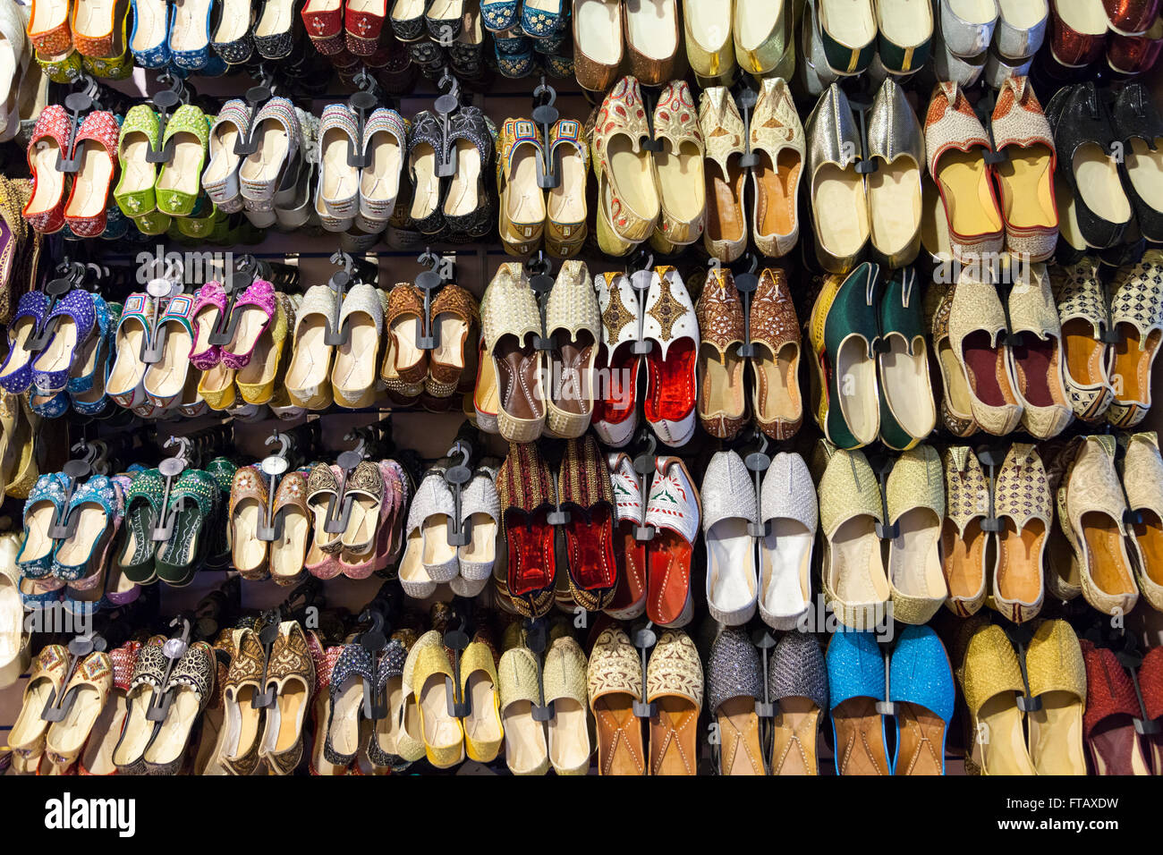 24d24038f424 Indian and Oriental shoes and slippers on display in footwear shop ...